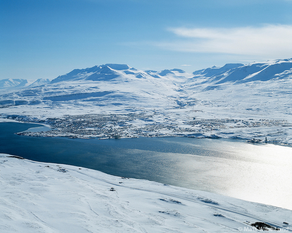 Akureyri, aerial viewing southwest with mount Súlur/ Sulur and Hliðarfjall / Hlidarfjall (right) in background.