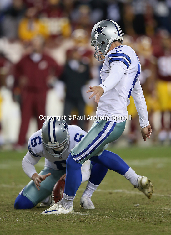 Dallas Cowboys punter Chris Jones (6) holds while Dallas Cowboys kicker Dan Bailey (5) kicks a late fourth quarter extra point that gives the Cowboys a 16-9 lead during the 2015 week 13 regular season NFL football game against the Washington Redskins on Monday, Dec. 7, 2015 in Landover, Md. The Cowboys won the game 19-16. (©Paul Anthony Spinelli)