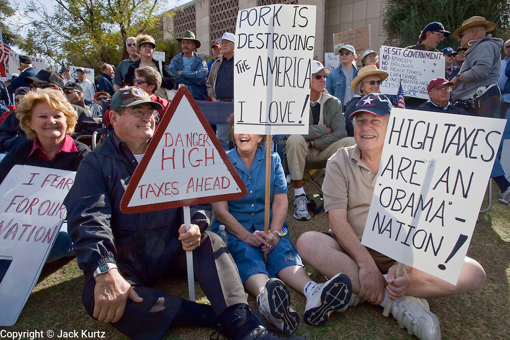 """Apr. 15, 2009 -- PHOENIX, AZ: Tax protestors during the """"Tea Party"""" at the Arizona State Capitol in Phoenix Wednesday. Nearly 10,000 people attended the rally, which was supposed to be in opposition to the Obama economic plan but turned into a general anti-Obama rally.  Photo by Jack Kurtz"""