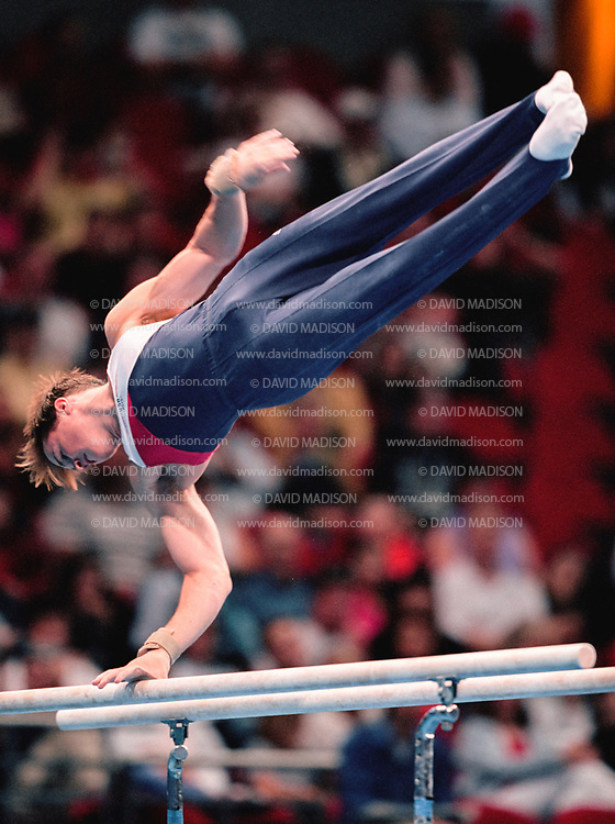 SYDNEY - SEPTEMBER 1:  Morgan Hamm of the United States competes on the parallel bars during the Men's Gymnastics events of the Olympic Games during September 2000 in Sydney, Australia.  (Photo by David Madison/Getty Images)