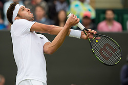 LONDON, ENGLAND - Monday, July 4, 2016:  Jiri Vesely (CZE) tangled up by trying to get a volley during the Gentlemen's Single 4th Round match on day eight of the Wimbledon Lawn Tennis Championships at the All England Lawn Tennis and Croquet Club. (Pic by Kirsten Holst/Propaganda)