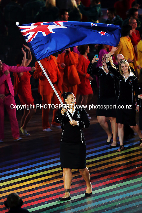 Valerie Adams leads Team New Zealand into the Celtic Park Satdium. Opening Ceremony of the Glasgow 2014 Commonwealth Games at Celtic Park, Glasgow, Scotland. Wednesday 23rd July 2014. Photo: Anthony Au-Yeung / photosport.co.nz