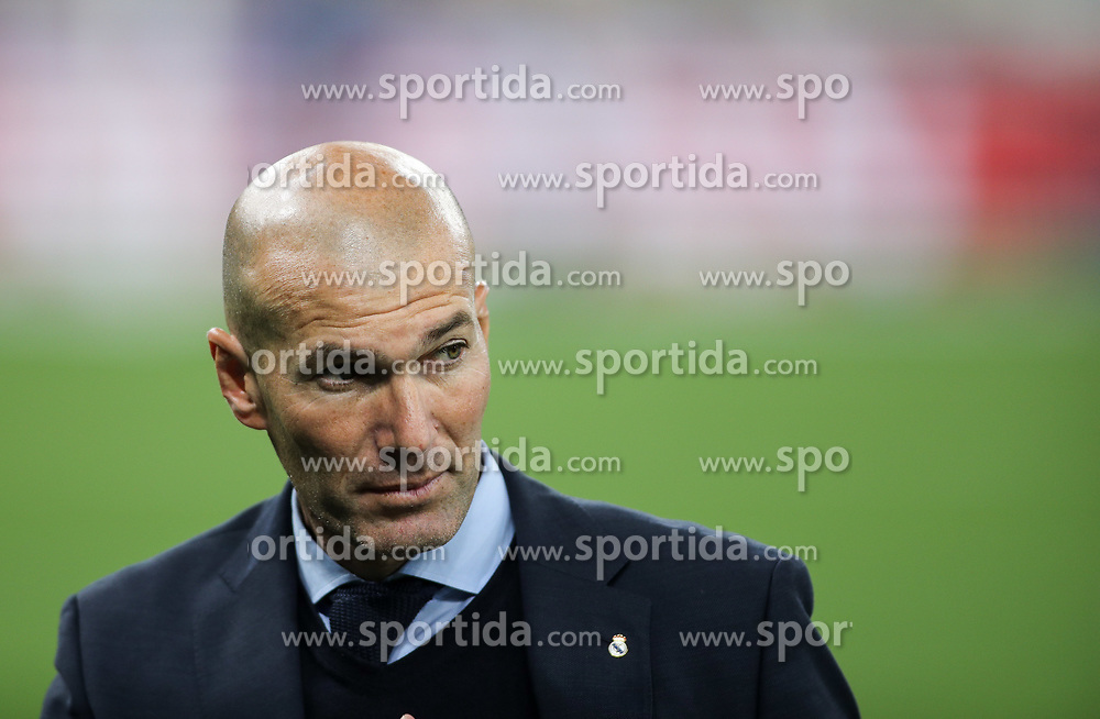 Zinédine Zidane, head coach of Real Madrid on the pitch as Real Madrid players celebrate winning the UEFA Champions League final football match between Liverpool and Real Madrid at the Olympic Stadium in Kiev, Ukraine on May 26, 2018. - Real Madrid defeated Liverpool 3-1. Photo by Andriy Yurchak / Sportida