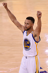 The Golden State Warriors' Stephen Curry celebrates after defeating the Cleveland Cavaliers, 129-120, in Game 5 of the NBA Finals at Oracle Arena in Oakland, Calif., on Monday, June 12, 2017. (Photo by Jose Carlos Fajardo/Bay Area News Group/TNS) *** Please Use Credit from Credit Field ***
