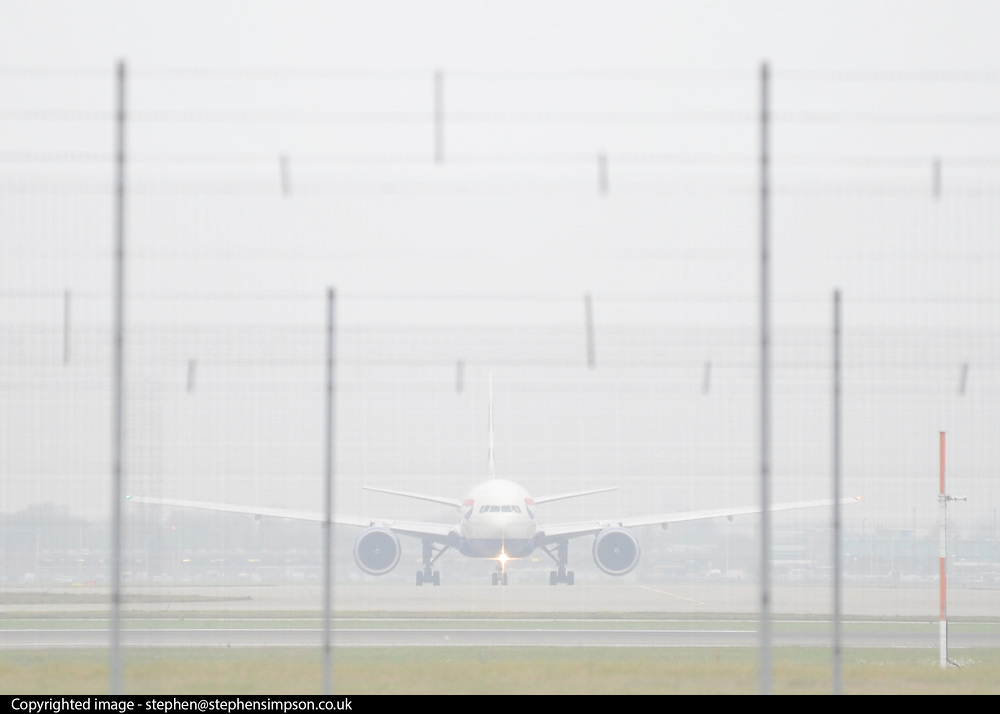 © Licensed to London News Pictures. 21/11/2011, Heathrow, UK.  A flight taxies in the fog. Flight delays continue at London's Heathrow Airport today. By 6.30am today a total of 21 flights from Heathrow were already cancelled affecting destinations including Manchester, Glasgow, Amsterdam, Brussels, Stockholm, Cologne and Nice.. Photo credit : Stephen Simpson/LNP
