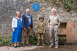 © Licensed to London News Pictures; 20/08/2020; Weston-super-Mare, UK. A plaque for former US President Dwight D. Eisenhower has been installed in Weston Woods near the water tower to commemorate the time that he stayed the night nearby with US troops as Supreme Allied Commander in preparation for D-Day in World War Two. Dwight D Eisenhower is the only American President to have set foot in Weston-super-Mare. As Supreme Allied Commander Europe he arrived in Weston towards the close of World War Two and stayed one night in 1944, en-route to the D-Day landings. The town was filled with American servicemen. Officers were billeted in hotels whilst other ranks slept under canvass in Ellenborough Park. Far from throwing around his status 'Ike' opted to sleep in a caravan parked near the water tower in Weston Woods, in the midst of military vehicles huddled under tree cover and along the Toll Road. Following the war, Eisenhower became NATO's first Supreme Commander and then President of the United States from 1953 until 1961. Left-right: Estelle Canniford, Mayoress of Weston-super-Mare; Councillor Mark Canniford, Mayor of Weston-super-Mare; Ivan Jeffrey age 10 wearing the uniform of the 101st Airborne and a member of the Airborne Misfit re-enactment group; John Crockford-Hawley, Chairman of the Weston-super-Mare Museum Committee. Photo credit: Simon Chapman/LNP.