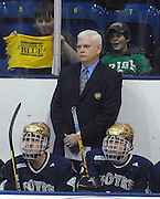 Notre Dame head coach Jeff Jackson and the Irish bench watch as the team trainer attends to an injured team mate during the first period of their Saturday night game against Lake Superior State in Sault Ste. Marie.