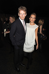 PATRICK KIELTY and girlfriend at the annual Serpentine Gallery Summer Party in Kensington Gardens, London on 9th September 2008.