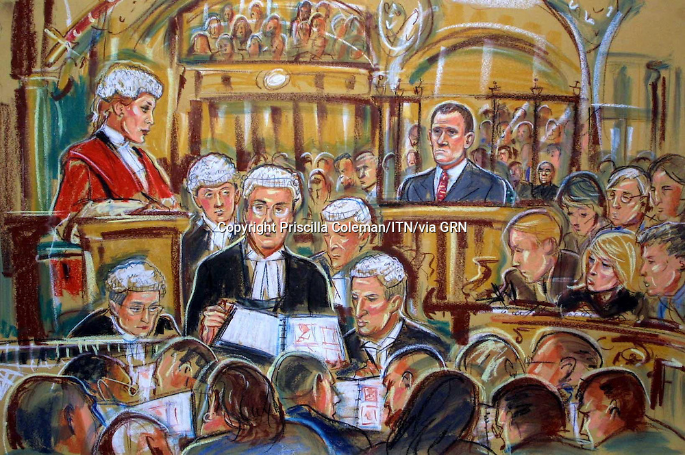 COPYRIGHT PRISCILLA COLEMAN ITV ARTIST 14.10.02.PIC SHOWS: PAUL; BURRELL IN THE DOCK AT THE OLD BAILEY TODAY WITH PROSECUTION AND DEFENCE LOOKING  THROUGH PHOTOGRAPHS ALLEGED TO HAVE BEEN STOLEN FROM PRINCESS DIANA WHILST HE WORKED AS HER BUTLER.