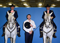 Ben Cohen attends photocall with Andalusian horses Vejador ridden by Fernando Arizo (L) and Teclado, ridden by Juan Rubio (R). Ex England rugby player and Strictly Come Dancing star takes part in photocall with two Andalusian horses to mark the start of The London International Horse Show, which runs 16-22 December, London, United Kingdom. Monday, 16th December 2013. Picture by Nils Jorgensen / i-Images