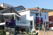 Tamarama Beach, Sydney, Australia. Staurday 25th April 2020. Locals at Tamarama beach celebrate Anzac Day at home by displaying the Australian national flag. Anzac Day services have been cancelled due to COVID-19 pandemic.