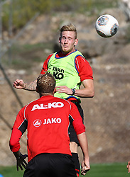 06.01.2014, Hotel Sheraton Salobre, Maspalomas, ESP, FC Augsburg Trainingslager, im Bild Andre Hahn (FC Augsburg #28), Kopfball, Alexander Esswein (FC Augsburg #11, re )<br /> <br /> Fussball, Bundesliga, FC Augsburg, FCA, Trainingslager, Gran Canaria, Maspalomas, Saison 2013 - 2014, 05+06 01 2014,<br /> Foto: Eibner // during a practice session of the German Bundesliga Club Borussia Dortmund at their training camp at the Hotel Sheraton Salobre in Maspalomas, Spain on 2014/01/06. EXPA Pictures © 2014, PhotoCredit: EXPA/ Eibner-Pressefoto/ Krieger<br /> <br /> *****ATTENTION - OUT of GER*****
