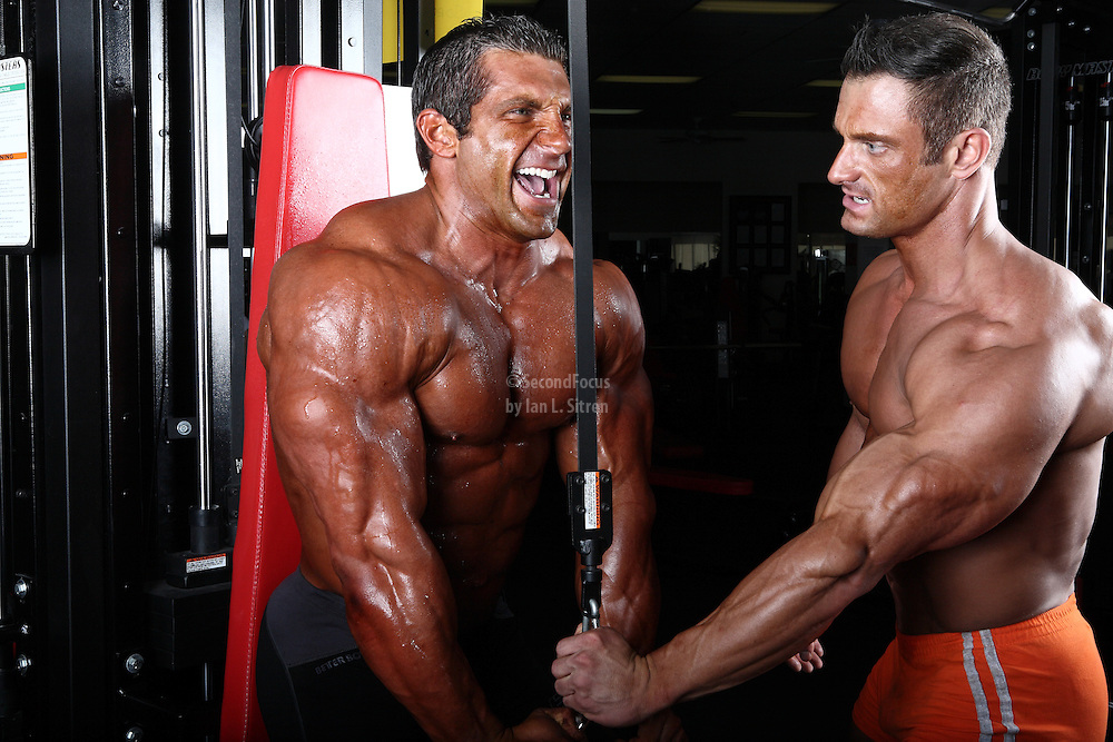 Bodybuilders Dan Decker and Brian Yersky doing a cable triceps workout.