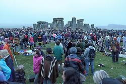 Summer Solstice<br /> Summer Solstice celebrations. This is the 14th year that English Heritage has provided free access to the stones. A very dull and bleak Summer Solstice reflects the ongoing poor British Summer of 2013,<br /> Stonehenge, Wiltshire, UK. <br /> Thursday, 20th June 2013<br /> Picture by Rosalind  Butt / i-Images