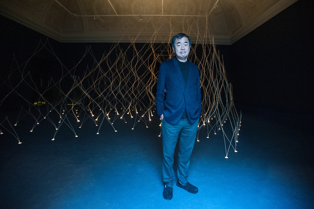London, UK - 21 January 2014: architect Kengo Kuma poses next to their installation at the Sensing Spaces: Architecture Reimagined exhibition at the Royal Academy of Arts