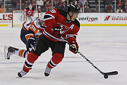 Apr 10, 2010; Newark, NJ, USA; New Jersey Devils left wing Zach Parise (9) skates with the puck during the first period at the Prudential Center.