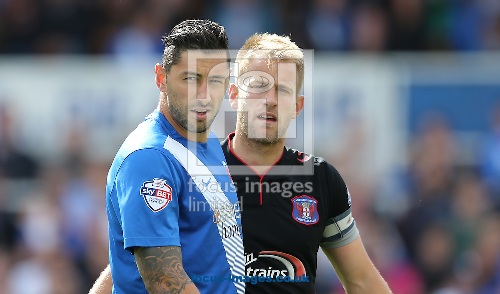 Billy Paynter (l) of Hartlepool United and Danny Grainger of Carlisle United during the Sky Bet League 2 match at Victoria Park, Hartlepool<br /> Picture by Simon Moore/Focus Images Ltd 07807 671782<br /> 29/08/2015