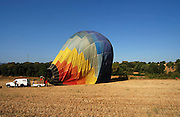 Spain; Catalonia, ground crew inflating a hot air balloon