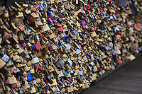 Padlocks are joined on the Pont Des Arts, near The Louvre Museum, to symbolise love in Paris, France.