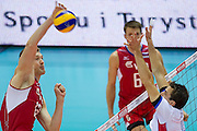 (L) Dmitriy Muserskiy from Russia in action during the 2013 CEV VELUX Volleyball European Championship match between Russia v Slovakia at Ergo Arena in Gdansk on September 24, 2013.<br /> <br /> Poland, Gdansk, September 24, 2013<br /> <br /> Picture also available in RAW (NEF) or TIFF format on special request.<br /> <br /> For editorial use only. Any commercial or promotional use requires permission.<br /> <br /> Mandatory credit:<br /> Photo by &copy; Adam Nurkiewicz / Mediasport