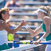 August 22, 2016, New Haven, Connecticut: <br /> Annika Beck of Germany shakes hands after being defeated by Eugenie Bouchard of Canada during a match on Day 4 of the 2016 Connecticut Open at the Yale University Tennis Center on Monday August  22, 2016 in New Haven, Connecticut. <br /> (Photo by Billie Weiss/Connecticut Open)
