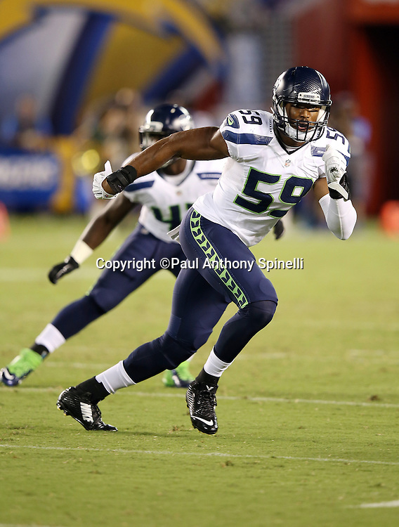 Seattle Seahawks defensive end Obum Gwacham (59) chases the action during the 2015 NFL preseason football game against the San Diego Chargers on Saturday, Aug. 29, 2015 in San Diego. The Seahawks won the game 16-15. (©Paul Anthony Spinelli)