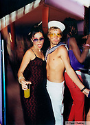 Man wearing a sailor outfit, girl wearing a dark red embroidered dress, Ibiza, 2000