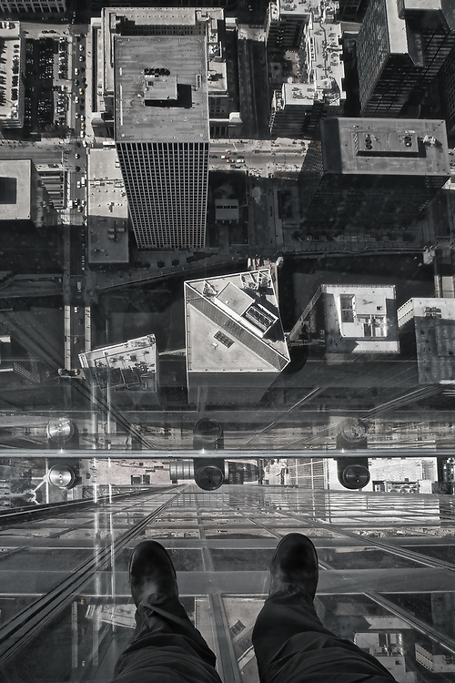 This photo was taken from one of the 3 glass boxes hanging on the side of the 103rd floor of the Sears/Willis Tower in Chicago. The tallest building in the western hemisphere and the third tallest in the world. At 1,353 feet (412m) in the air, the Ledge's glass boxes extend out 4.3 feet from Skydeck.