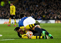 Everton's Muhamed Besic tangles with Alexander Gerndt of BSC Young Boys  - Photo mandatory by-line: Matt McNulty/JMP - Mobile: 07966 386802 - 26/02/2015 - SPORT - Football - Liverpool - Goodison Park - Everton v Young Boys - UEFA EUROPA LEAGUE ROUND OF 32 SECOND LEG