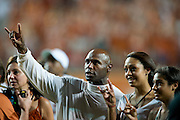 AUSTIN, TX - AUGUST 30:  Texas Longhorns head coach Charlie Strong celebrates after defeating the North Texas Mean Green on August 30, 2014 at Darrell K Royal-Texas Memorial Stadium in Austin, Texas.  (Photo by Cooper Neill/Getty Images) *** Local Caption *** Charlie Strong