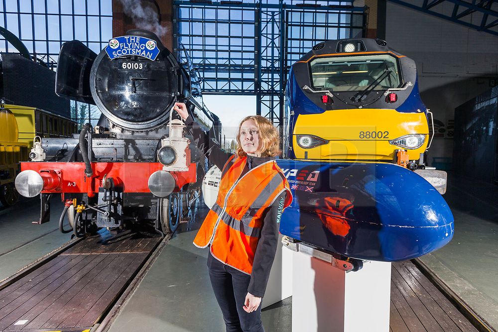 © Licensed to London News Pictures. 26/04/2018. York UK. Picture shows Elizabeth Usher with the Flying Scotsman, a Electro-Diesel Class 88 & the UK's first Hyperloop Pod representing the past, present & future of Rail travel at York rail museum this morning. The revolutionary Hyperloop technology could see passenger pods travelling inside near-vacuum tubes at speeds of up to 650 mph and could theoretically reduce York to London journey times to just 20 minutes. The Hyperloop pod is at the museum to launch the museum's new visual identity & to mark the occasion bought together the past, present & future of rail travel. Photo credit: Andrew McCaren/LNP