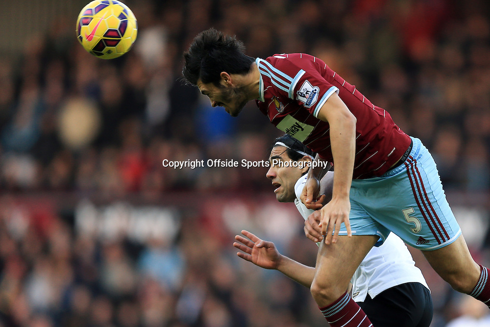 8 February 2015 - Barclays Premier League - West Ham United v Manchester United - Radamel Falcao of Manchester United in action with James Tomkins of West Ham - Photo: Marc Atkins / Offside.