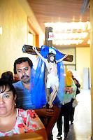 A devotee and his family walk by confessions held on the first floor of Sherwood Community Hall in Salinas on Sunday. The 23rd annual Congress of Charismatic Catholics included prayer groups from San Benito, Santa Cruz and Monterey Counties.