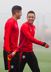 Memphis Depay of Manchester United laughs with Marcos Rojo - Mandatory byline: Matt McNulty/JMP - 07966386802 - 02/11/2015 - FOOTBALL - Aon Training Complex -Manchester,England - UEFA Champions League