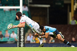 March 23, 2019 - Sydney, NSW, U.S. - SYDNEY, NSW - MARCH 23: Crusaders player Matt Todd (7) tackled by Waratahs player Israel Folau (15) at round 6 of Super Rugby between NSW Waratahs and Crusaders on March 23, 2019 at The Sydney Cricket Ground, NSW. (Photo by Speed Media/Icon Sportswire) (Credit Image: © Speed Media/Icon SMI via ZUMA Press)