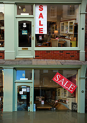 © Licensed to London News Pictures. 27/12/2016. York, UK. Side by side comparison pictures showing a shop on Walmgate in the centre of York as it is today, December 27, 2016 (TOP), and exactly a year ago today, on December 27, 2015 (BOTTOM) during the middle of severe flooding. Homes and businesses were destroyed in the flooding over the Christmas period last year. Photo credit: Ben Cawthra/LNP