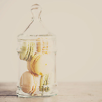 a glass jar filled with sweet french macarons