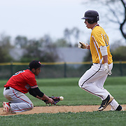 William Penn Infielder Ryan Juarez-Robertson (3), LEFT, attempts to recover the ball as St. Elizabeth Infielder William Vernon (10) reaches second base during of a varsity scheduled game between the Colonials of William Penn and The St. Elizabeth Vikings Saturday, April 25, 2015, at William Penn High School baseball field in New Castle Delaware.<br /> <br /> William Penn defeats St. Elizabeth 6-5