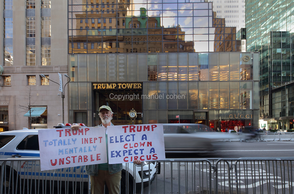Man protesting against the presidency of Donald Trump in front of Trump Tower, on Fifth Avenue, Manhattan, New York, New York, USA. Trump Tower was designed by  Der Scutt and built 1979-83 for Trump and the Equitable Life Assurance Company. Donald Trump was elected President of the United States in November 2016. Picture by Manuel Cohen