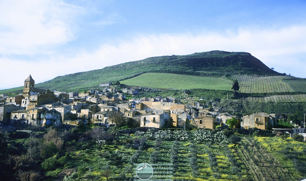 Sicilian countryside with ruins of 16th century old town Poggioreale in Italy. Sicily (Italian: Sicilia [siˈtʃiːlja]) is the largest island in the Mediterranean Sea; along with surrounding minor islands, it constitutes an autonomous region of Italy, the Regione Siciliana (Sicilian Region).<br />