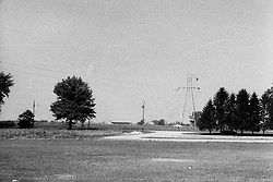 mid 1970's - storms blow down power lines from high voltage transmission towers in Heyworth Illinois<br /> <br /> <br /> Archive slide, negative and print scans.