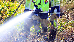 10 Fire Trucks from South Auckland stations are dampening down hot spots following a large out-of-control scrub fire, which posed a threat to neighbouring properties at Kohuora Crater Wetland in Papatoetoe, Auckland, New Zealand, Thursday, December 28, 2017. Credit:SNPA / Hayden Woodward**NO ARCHIVING**