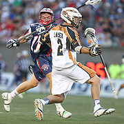 Dave Lawson #2 of the Rochester Rattlers keeps the ball away from Matt Smalley #11 of the Boston Cannons during the game at Harvard Stadium on August 9, 2014 in Boston, Massachusetts. (Photo by Elan Kawesch)
