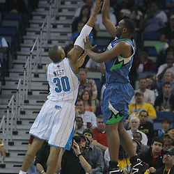 08 February 2009: Minnesota Timberwolves center Al Jefferson (25) shoots over New Orleans Hornets forward David West (30) during a NBA game between the Minnesota Timberwolves and the New Orleans Hornets at the New Orleans Arena in New Orleans, LA.