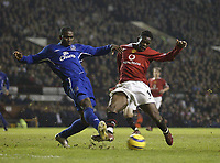 Photo: Aidan Ellis.<br /> Manchester United v Everton. The Barclays Premiership.<br /> 11/12/2005.<br /> United's Louis Saha comes close with this effort as Everton's Joseph Yobo defends
