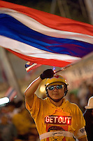 "BANGKOK, THAILAND  -  March 14: Tens of tousands of demonstrators seeking the resignation of Prime Minister Thaksin Shinawatra protest at the Grand Palace March 13, 2006 in Bangkok, Thailand. The protesters surrounded Thaksin's office chanting ""Thaksin Get Out"", as the Prime Minister threatened a state of emergency if the demonstration turned violent.  (Photo by David Paul Morris) ."