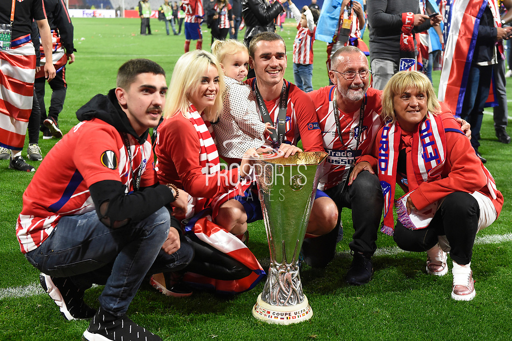 Forward Antoine Griezmann of Atletico de Madrid celebrates the victory with his family with Europa League trophy after the UEFA Europa League, Final football match between Olympique de Marseille and Atletico de Madrid on May 16, 2018 at Groupama Stadium in Decines-Charpieu near Lyon, France - Photo Jean-Marie Hervio / ProSportsImages / DPPI
