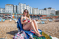 © Licensed to London News Pictures. 07/05/2018. Brighton, UK. 37 year old SILVANIA SIMAO from Brazil spent the day on Brighton and Hove beach on the May Bank Holiday Monday as warm weather continues to hit the seaside resort. This weekend has been the hottest May Bank Holiday weekend on record. Photo credit: Hugo Michiels/LNP