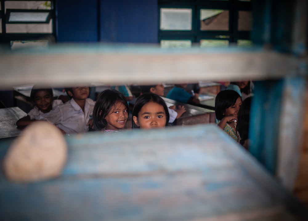 Students looking through school window (Vietnam)