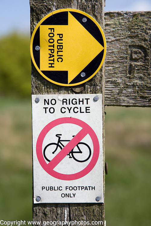 Public footpath sign no right to cycle sign close up